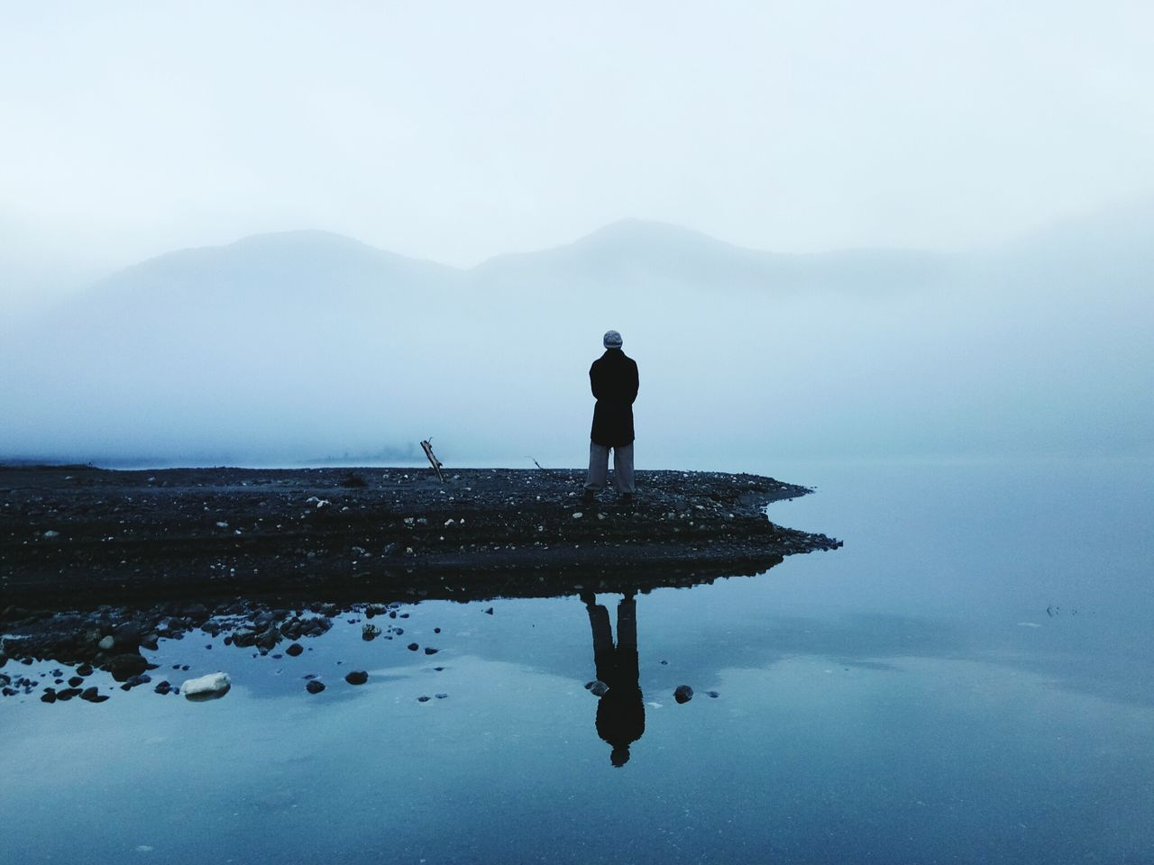 One Person Reflection One Man Only Fog Lake Mountain Water Full Length Outdoors Standing Photographing Nature Reserve Reflection_collection 3XSPUnity Cloud - Sky Eyem Best Shots Nature_collection Eyem Nature Lover Mountain Range Tranquil Scene EyeEm Best Shots - Landscape EyeEmNewHere Beauty In Nature