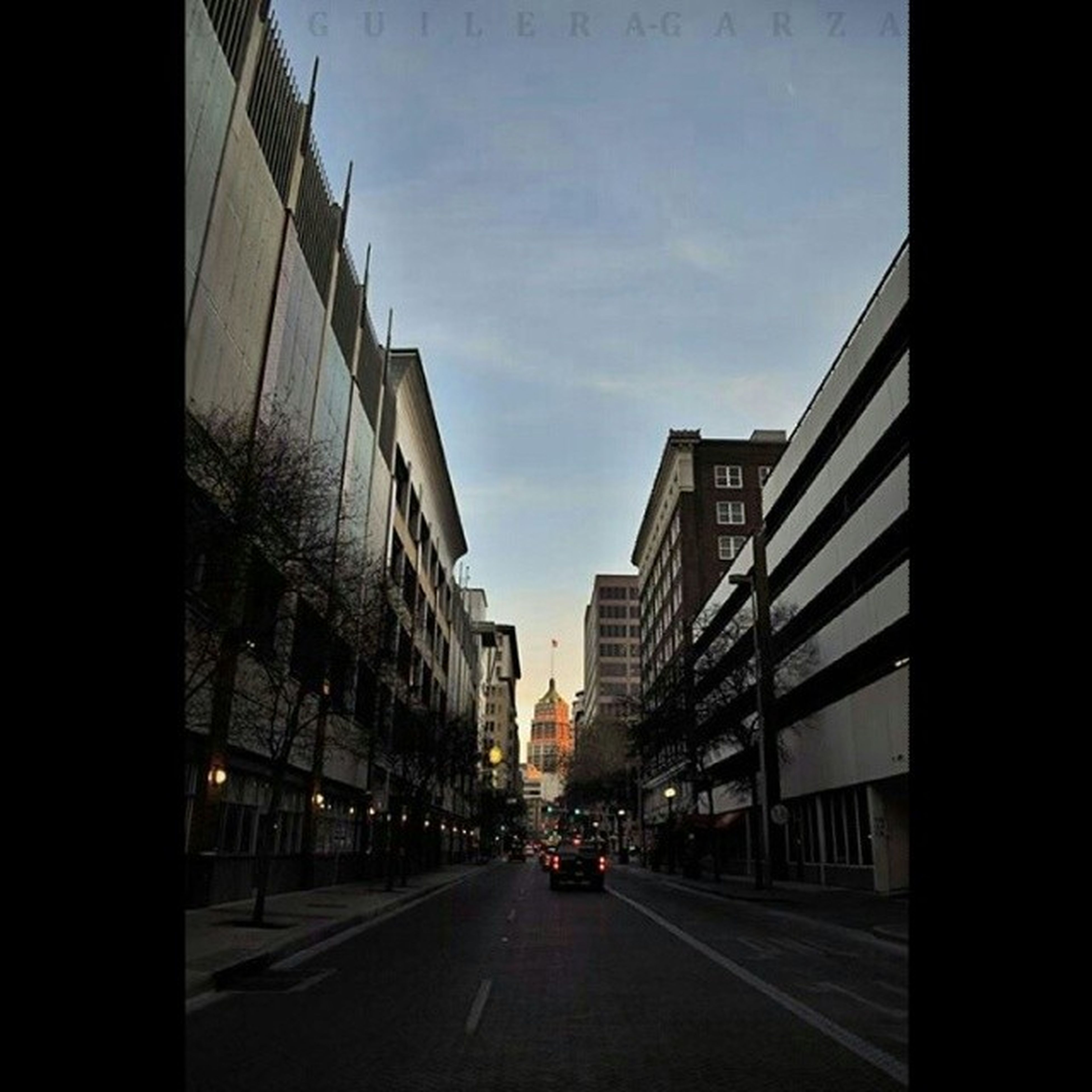 architecture, building exterior, built structure, the way forward, transportation, city, road, diminishing perspective, street, sky, road marking, car, building, vanishing point, city life, empty, outdoors, long, no people, city street