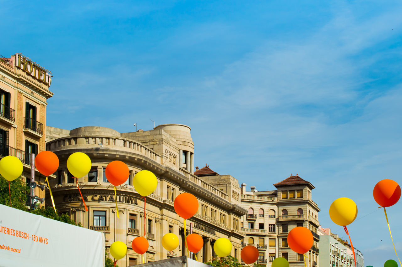 building exterior, architecture, built structure, day, low angle view, outdoors, balloon, sky, lantern, city, no people