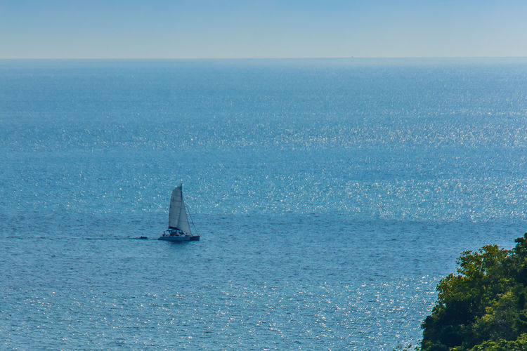 Colorful seascape with sail boat against deep blue sea under blue sky in the ocean on the cloudy day. PromThepCape Promthep Cape Beauty In Nature Blue Clear Sky Day Horizon Over Water Nature Nautical Vessel No People Outdoors Promthep Sailboat Sailing Scenics Sea Sky Transportation Water