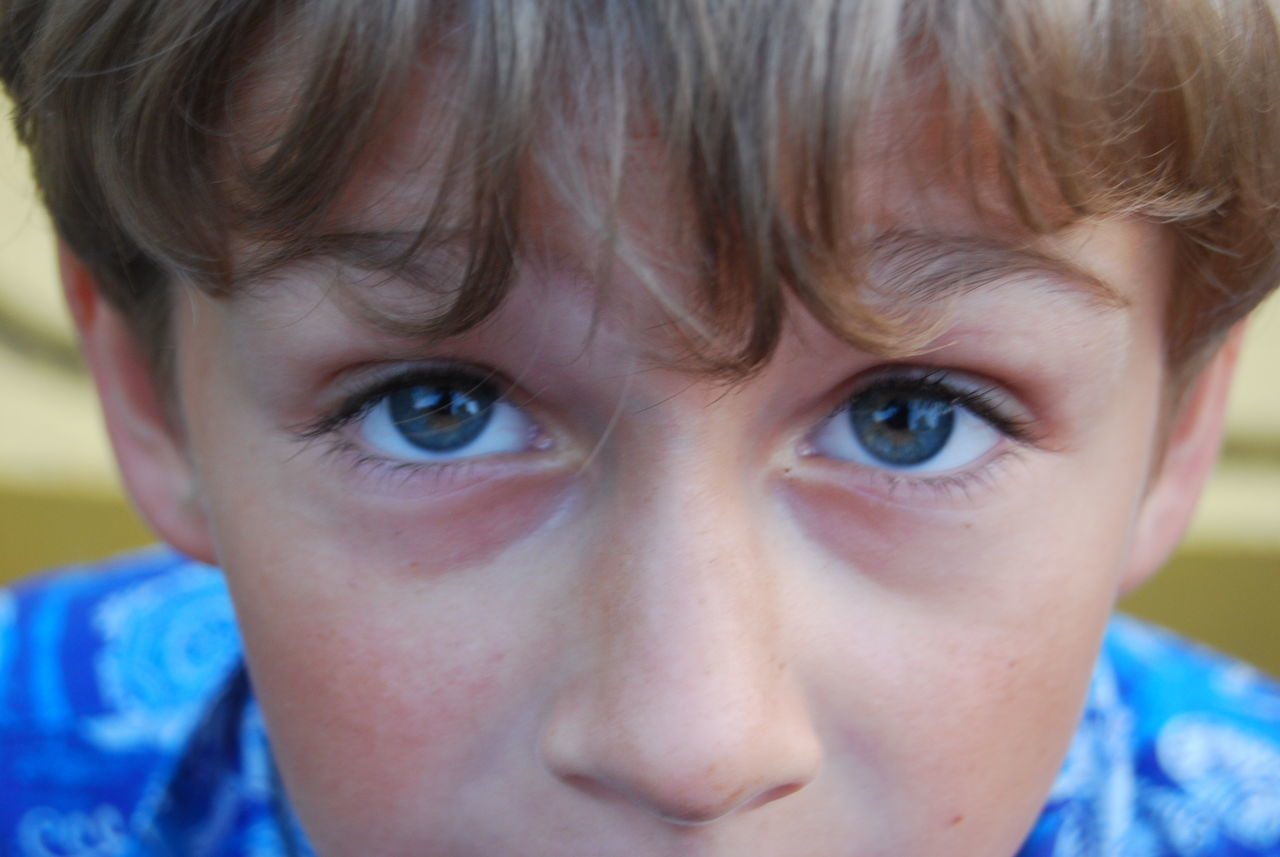 Portrait Looking At Camera One Person Human Body Part Close-up Human Eye Human Face Young Adult Blue Eyes Beauty Headshot People Eye Beautiful People Young Boy Young Boy Big Dreams Deep Blue Eyes One Young Boy Blue Shirt Childhood Days One Child Only Adults Only Adult One Woman Only Day
