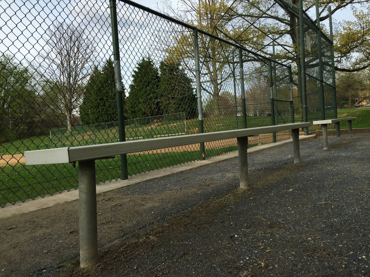 Architecture Baseball Baseball Bench Baseball Diamond Bench Built Structure Chainlink Fence Day Empty Fence Gate Grass Metal No People Park - Man Made Space Protection Railing Security Shadow Sky Sunlight Tree