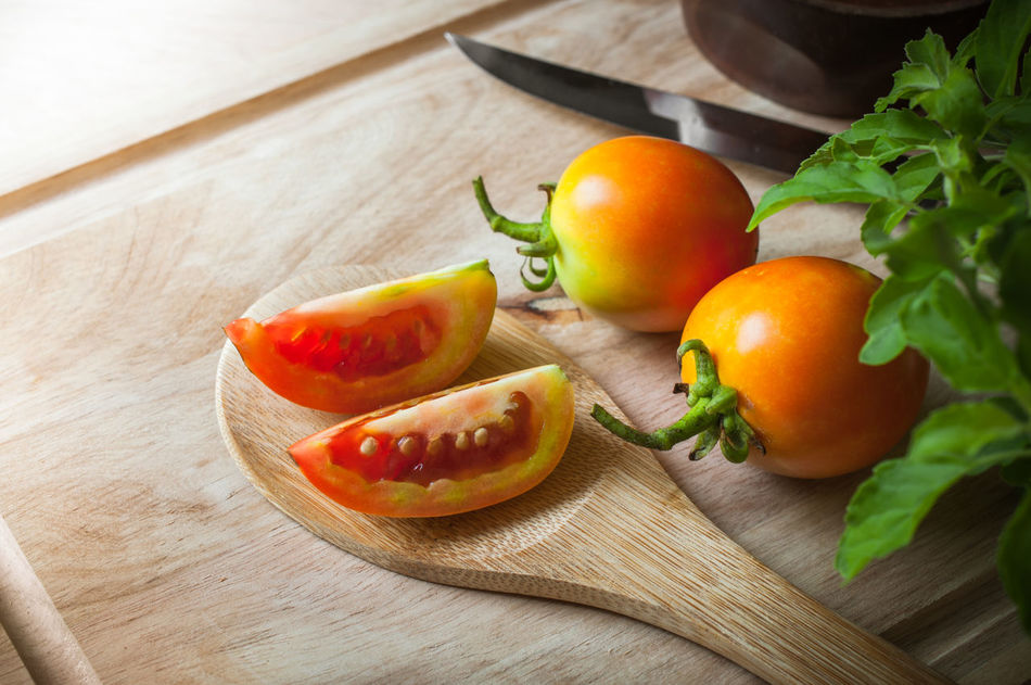 Agriculture Asian Food Basil Bio Food Close-up Culture Food Food Stylist Freshness Fruit Gourmet Healthy Eating Indoors  Kitchen Ladle No People Plant Raw Food Ready-to-eat Table Tomato Traditional Vegetable Wood - Material