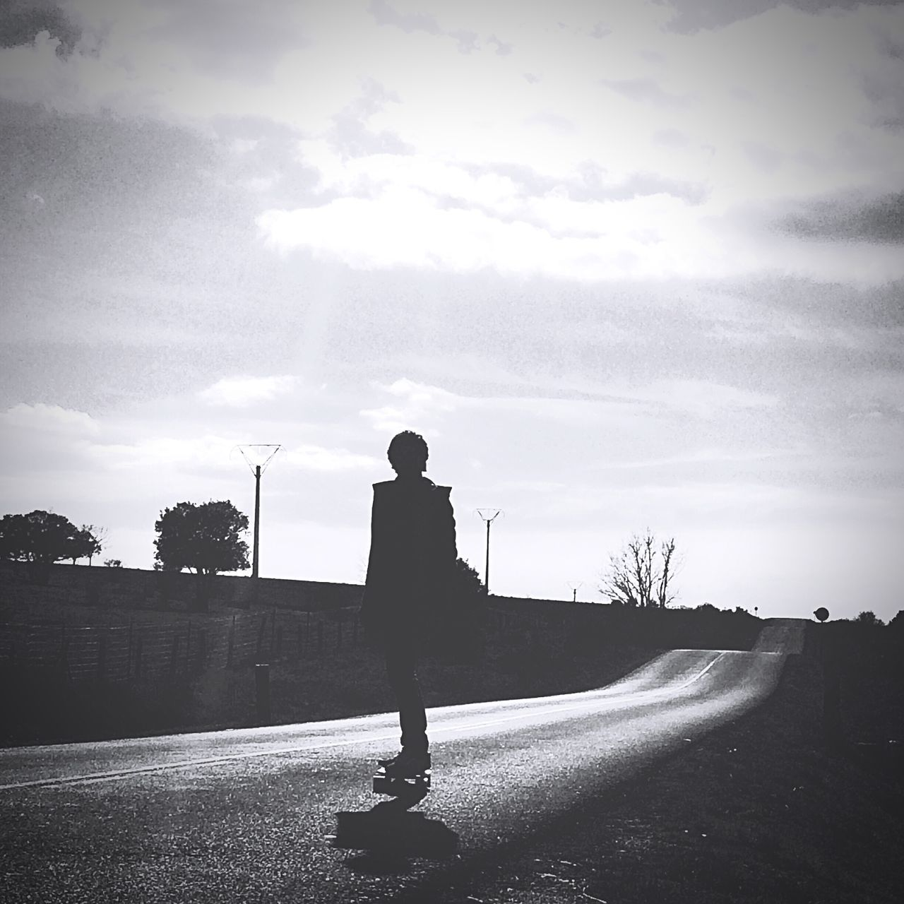 skating to home Blackandwhite BYOPaper! Full Length High Contrast Loneliness Long Way Home Longboard Longboarding One Person Outdoors Road Roadtrip Silhouette Skateboarding The Great Outdoors - 2017 EyeEm Awards The Portraitist - 2017 EyeEm Awards The Street Photographer - 2017 EyeEm Awards IPhoneography IPhone Shoot
