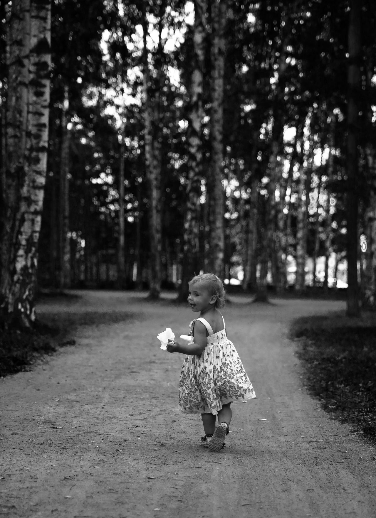 Black and white photos of baby girl playing alone with ball and walking in the garden Alone Alone Time Ball Balloons Black And White Black And White Photography Blurred Motion Child Dreaming Enjoying Life Evening Eye Family# Flower Dress Free Girl Looking At Camera Memories One Person Playing Pretty Running