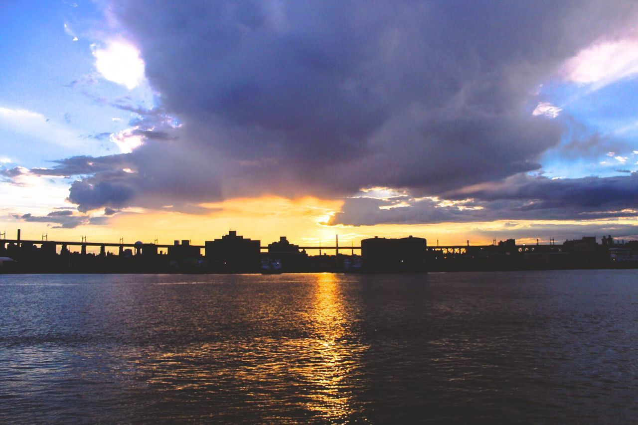 cloud - sky, sky, building exterior, sunset, built structure, waterfront, architecture, water, river, silhouette, nature, no people, outdoors, beauty in nature, city, rippled, tranquility, scenics, cityscape, travel destinations, urban skyline, day