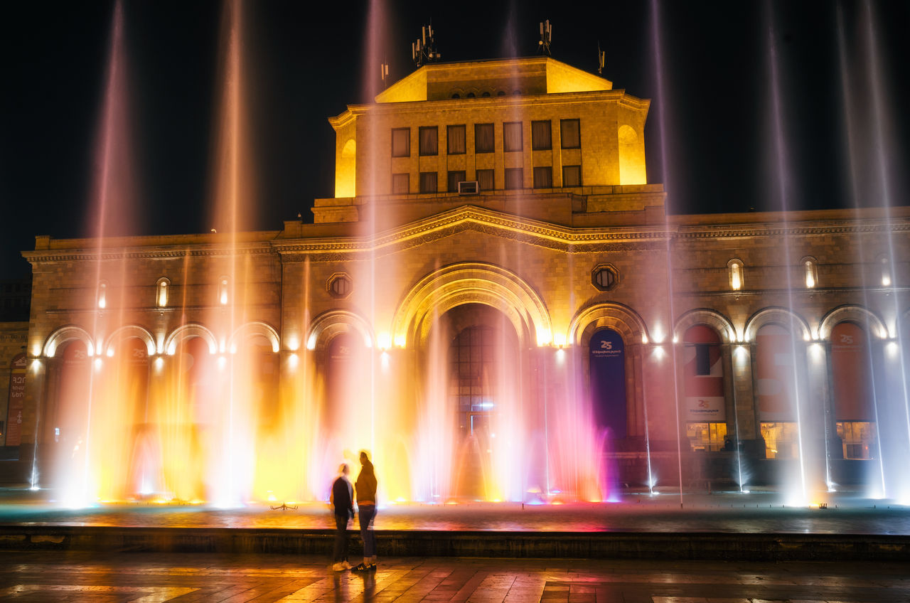 The colored singing musical dancing fountains against the building of the National Gallery and History Museum of Armenia on Republic Square Architecture Architecture Architecture_collection Armenia Building Exterior Capital Cities  Colors Couple Fountain Illuminated Landmark Long Exposure Museum Night Outdoors Square Tourism Travel Travel Destinations Yerevan