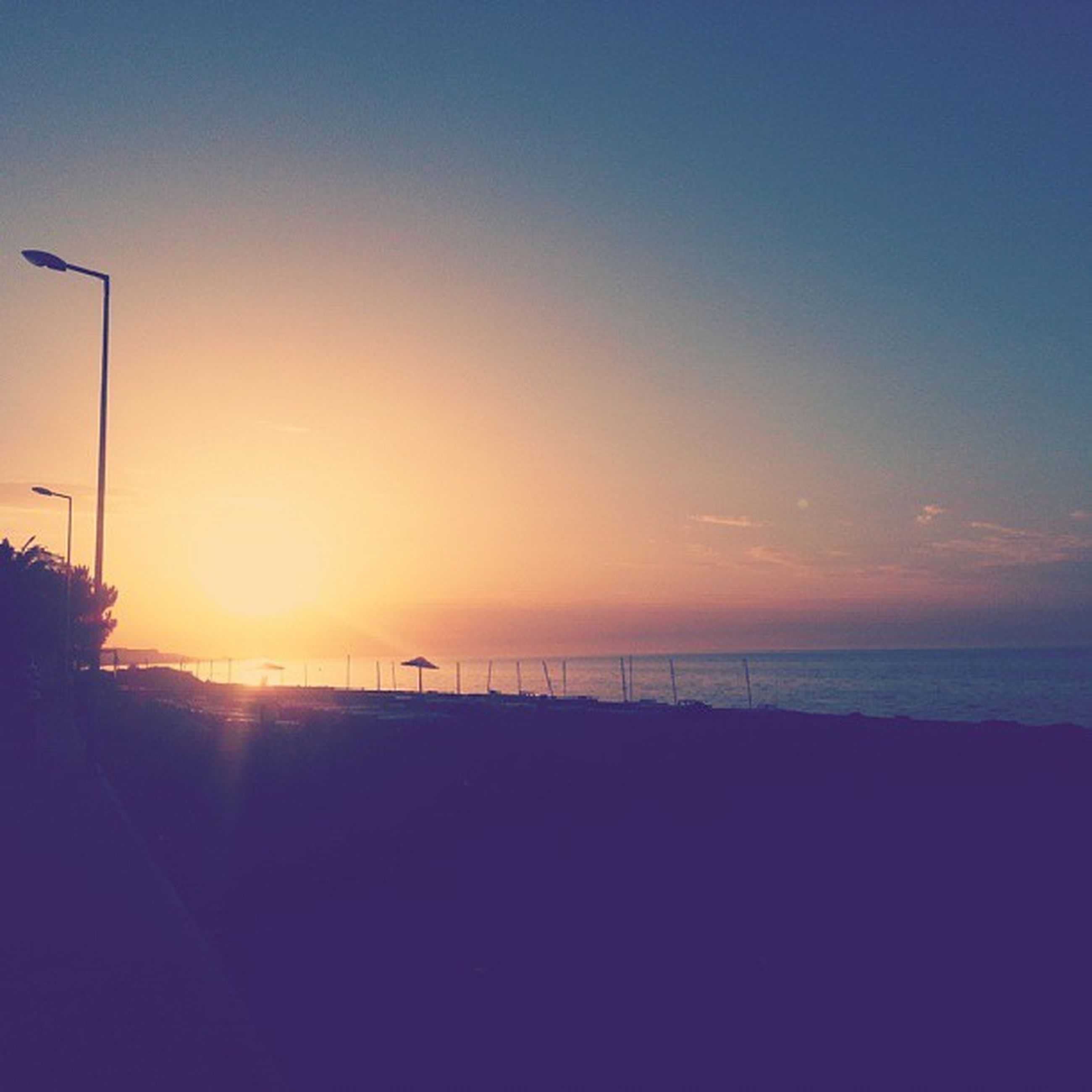 sunset, sea, horizon over water, tranquil scene, water, scenics, tranquility, silhouette, beauty in nature, sun, sky, nature, idyllic, copy space, beach, orange color, sunlight, clear sky, shore, outdoors
