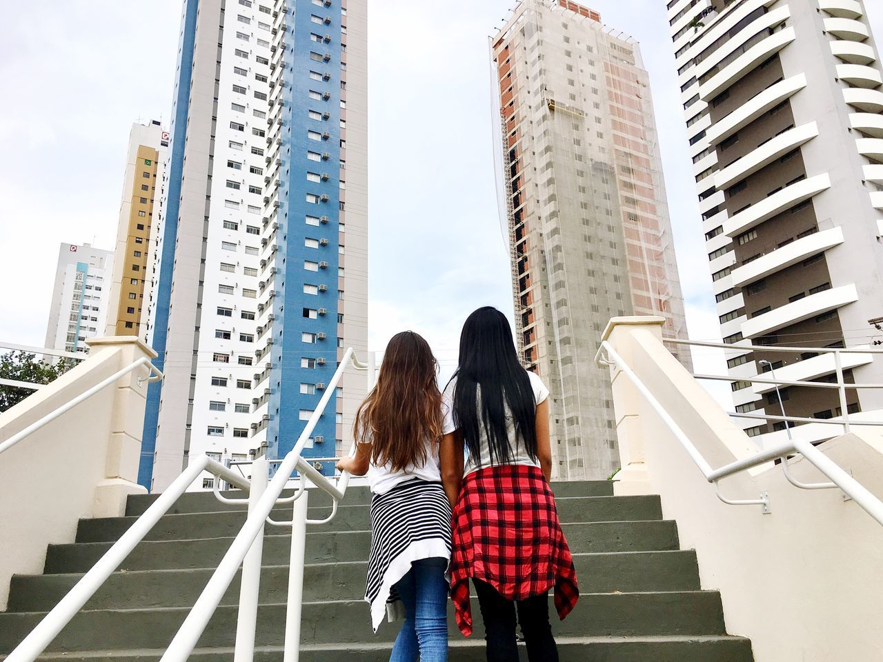 Two People Architecture Skyscraper Rear View Building Exterior Built Structure Togetherness City Women Real People Day Walking Steps And Staircases Modern Staircase City Life Casual Clothing Low Angle View Young Women Lifestyles Long Goodbye
