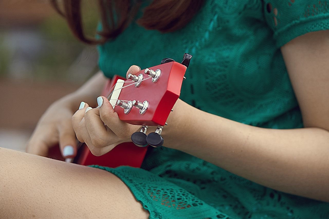 Russia Real People Girl Ukulele Human Body Part Midsection Holding Human Hand Leisure Activity Indoors  Lifestyles Two People Day Close-up Young Women Young Adult Adult People