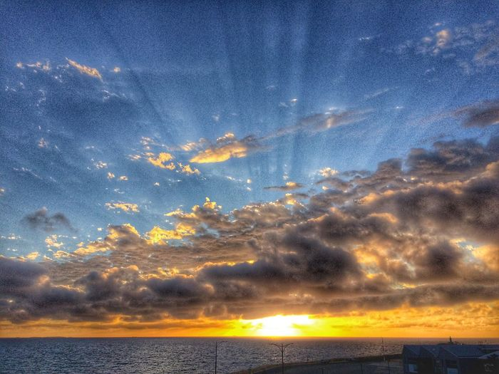 Sunrays Sea Sky Sunset Cloud - Sky Scenics Tranquility Beauty In Nature Nature Water Blue Outdoors Dramatic Sky