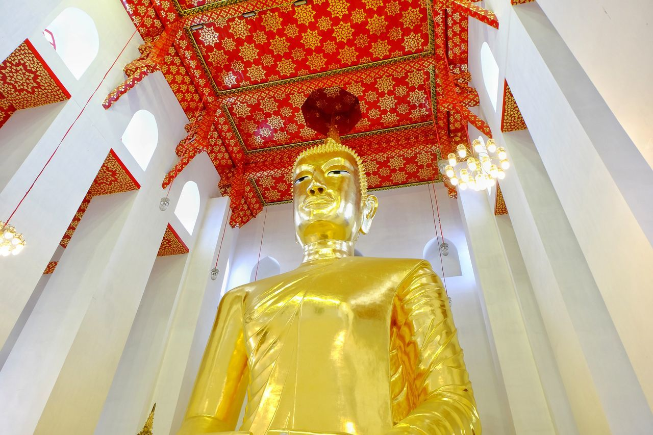 statue, spirituality, male likeness, religion, human representation, low angle view, sculpture, gold colored, art and craft, place of worship, indoors, idol, golden color, no people, built structure, day