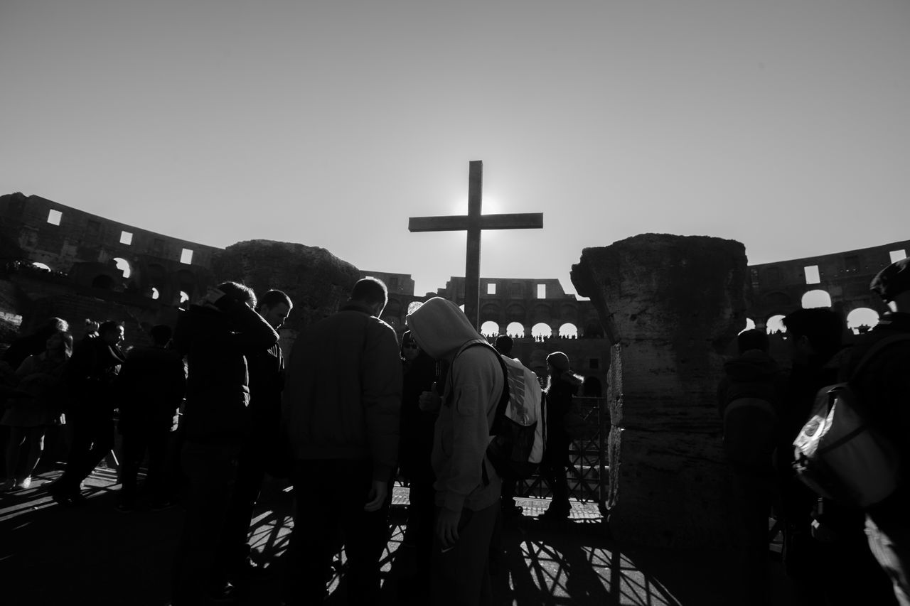 Adult Archival Black Black And White Blackandwhite Coloseum Cross Day Outdoors People Religion Rome Rome Italy Ruin Sky Spirituality Sun