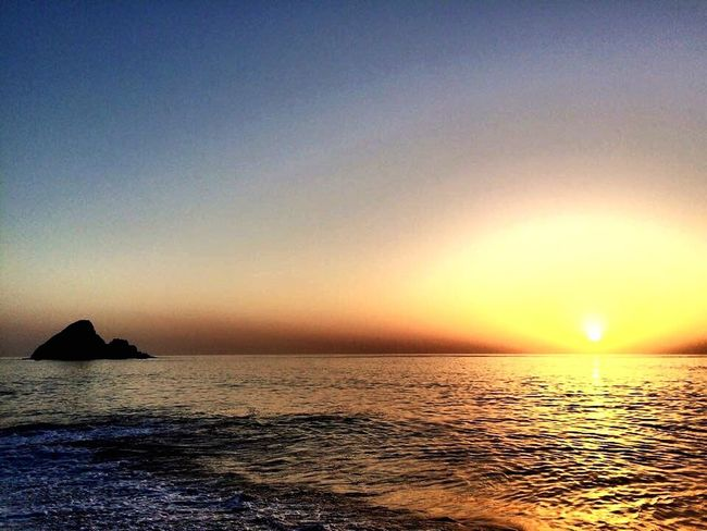 One sunset in fujairah camping site Fujairah Sunset Sun Camping Sea Shore Photography Check This Out Sand Humid Hot Day Day Hello World Friends Serenity Outdoors Water Sky Light And Shadow Light Waves Rock Islet Wind Yellow