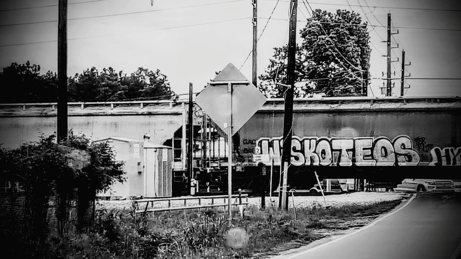 Check This Out Trains Waiting For Train To Pass Graffiti Graffiti On Trains Black And White Photography Train Photography Graffiti Writers Human Meets Technology Human Meets Old Technology
