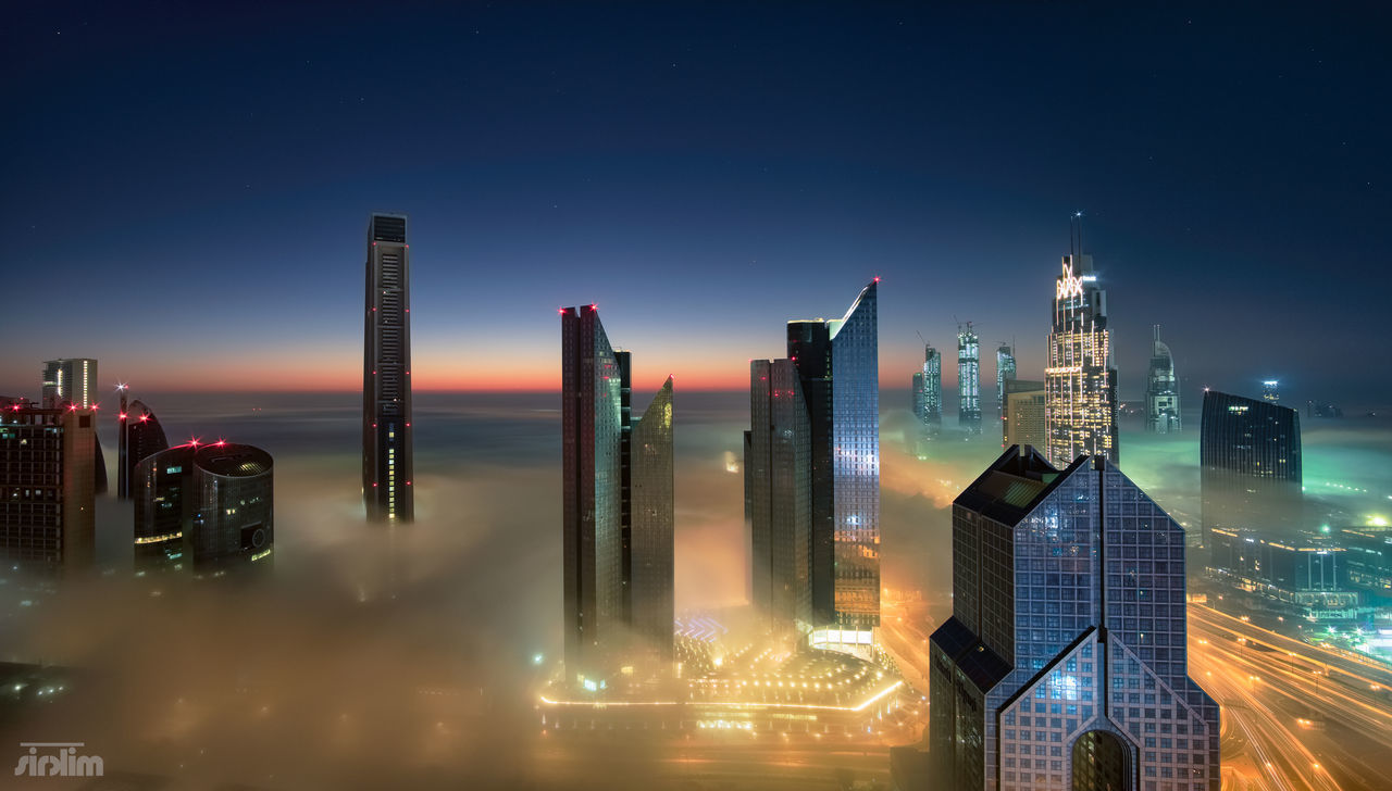 Cotton fields Skyscraper Urban Skyline Architecture Cityscape Modern Building Exterior City Downtown District Illuminated Night Travel Destinations Futuristic Built Structure Sunset No People Dubaifog Fog DXB Middleeast Fogshot Twilight Sheikh Zayed Business Finance And Industry Office Building Exterior Sky First Eyeem Photo