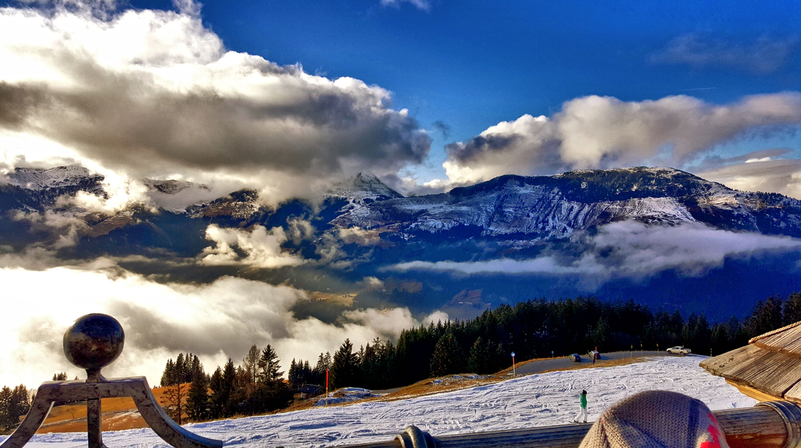 mountain, sky, cloud - sky, mountain range, snow, winter, weather, scenics, cold temperature, cloudy, beauty in nature, tranquil scene, tranquility, cloud, nature, season, landscape, snowcapped mountain, day, outdoors