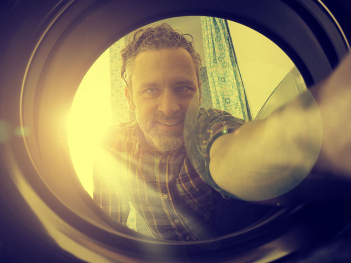 Man with washing machine Bright Happy Man Sunlight Washing Bathroom Clothes Day Dirty Exposure Fish-eye Lens Indoors  Lens Flares Looking At Camera Male One Person People Portrait Real People Smiling Smiling Face Technology Washing Machine