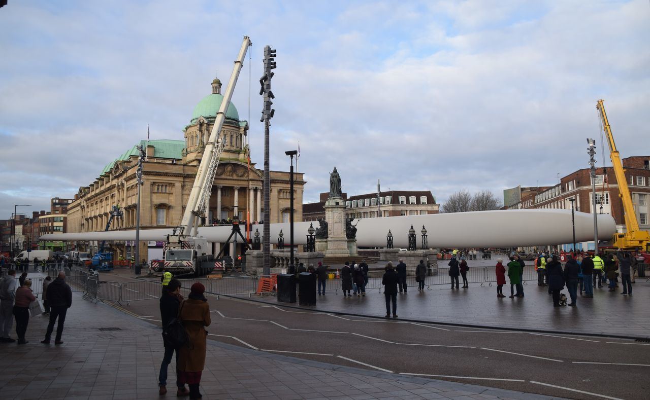 Siemens wind turbine blade is lifted into position in Hull's Queen Victoria Square (08/01/2017) during Hull 2017 City Of Culture Adult Architecture Blade Cultures Day Hull Hull 2017 Hull City Of Culture 2017 Hull2017 Large Group Of People Outdoors People Siemens  Sky Wind Turbine