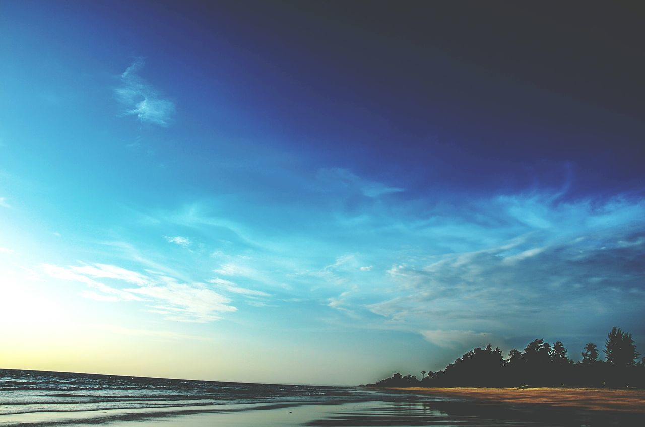 scenics, tranquil scene, sky, nature, tranquility, beauty in nature, water, cloud - sky, outdoors, sea, no people, landscape, blue, beach, horizon over water, day, tree