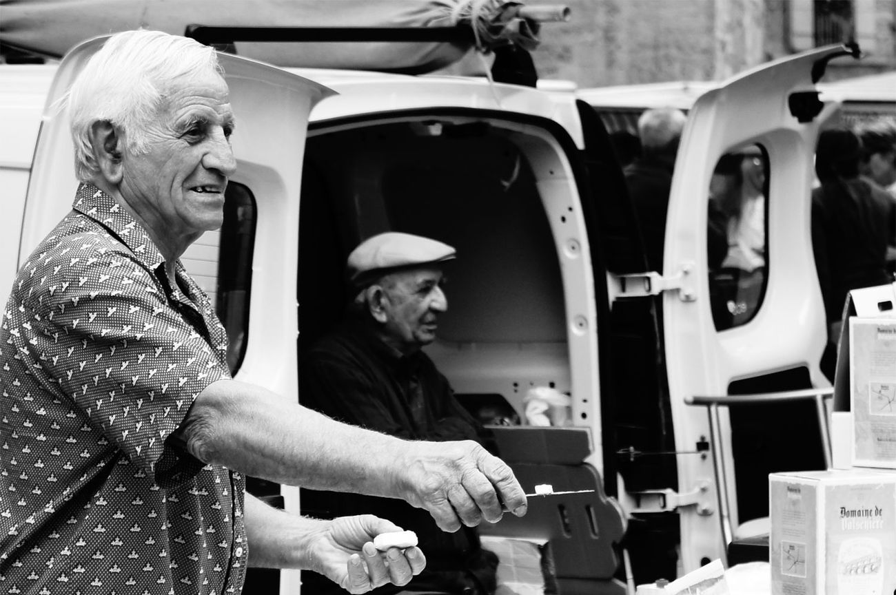 Market in Uzés France ; men selling Cheese ; Streetphotography_bw Monochrome Black And White ; Streetphotography The Difference Is Spreading Capture The Moment