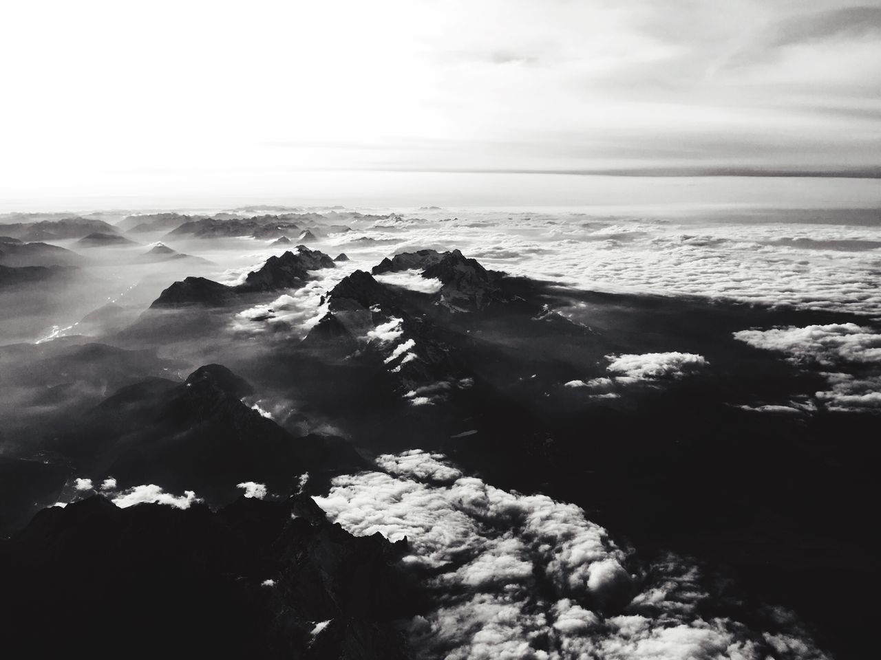 Sea Of Mountains Beauty In Nature Tranquility Sky No People View From Above Clouds And Mountains Flowing Flying Over Clouds Alpes Blackandwhite IPhoneography BYOPaper!