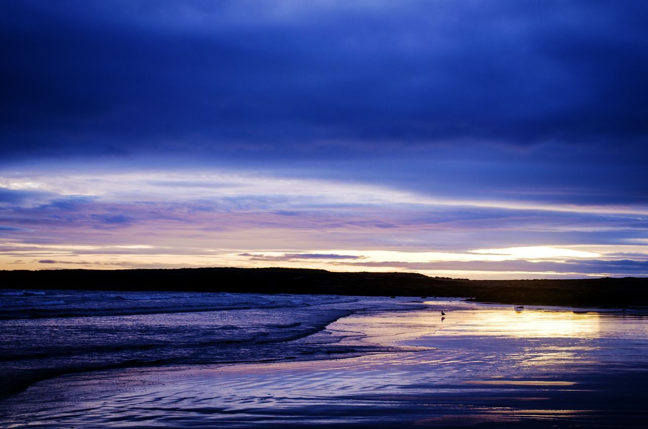 Sunset dew Beach Reflection Outdoors Sea Beauty In Nature Sunset Sky Sand Landscape Horizon Over Water Dramatic Sky Scenics Travel Journey Wales Nature Full Frame