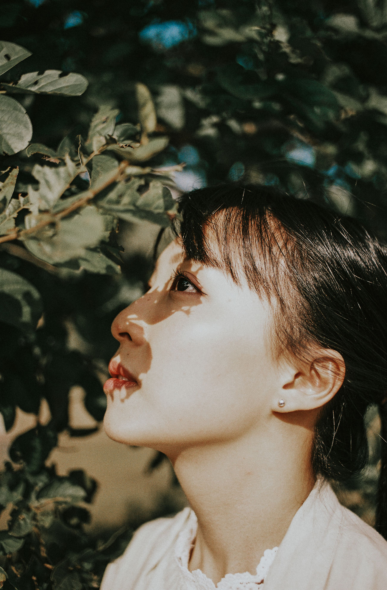 Beautiful Woman Close-up Day Flower Focus On Foreground Hair Bun Headshot Leaf Lifestyles Nature One Person One Young Woman Only Outdoors People Real People The Portraitist - 2017 EyeEm Awards Tree Young Adult Young Women