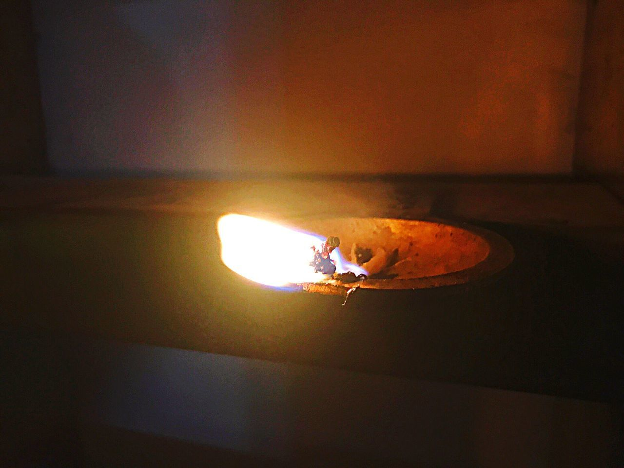 burning, flame, heat - temperature, glowing, indoors, illuminated, real people, men, one person, night, close-up, diya - oil lamp, people