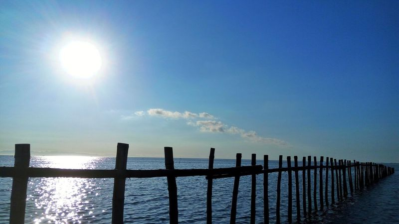 Railing Sea Water Safety Protection Wooden Post Sunlight Outdoors Day No People Sky Nature Horizon Over Water Beauty In Nature