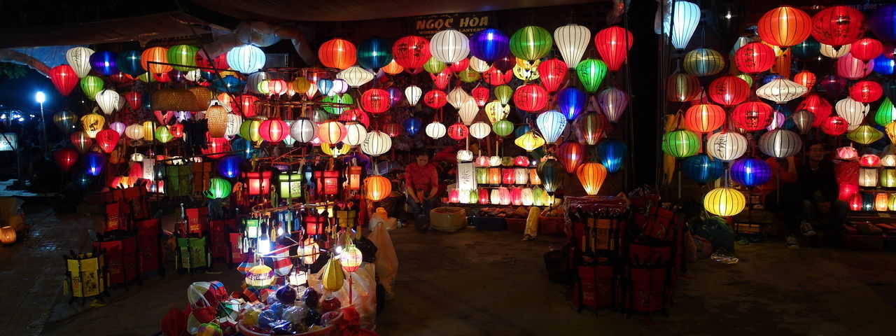 Lantern stall in the night market at Hoi An, Vietnam. Cultures Decoration Hanging Hoi An Illuminated Lamps Lampshade Lampshades Landscape Lantern Lanterns Large Group Of Objects Lighting Lights Market Market Stall Multi Colored Night Lights Vietnam Vietnamese