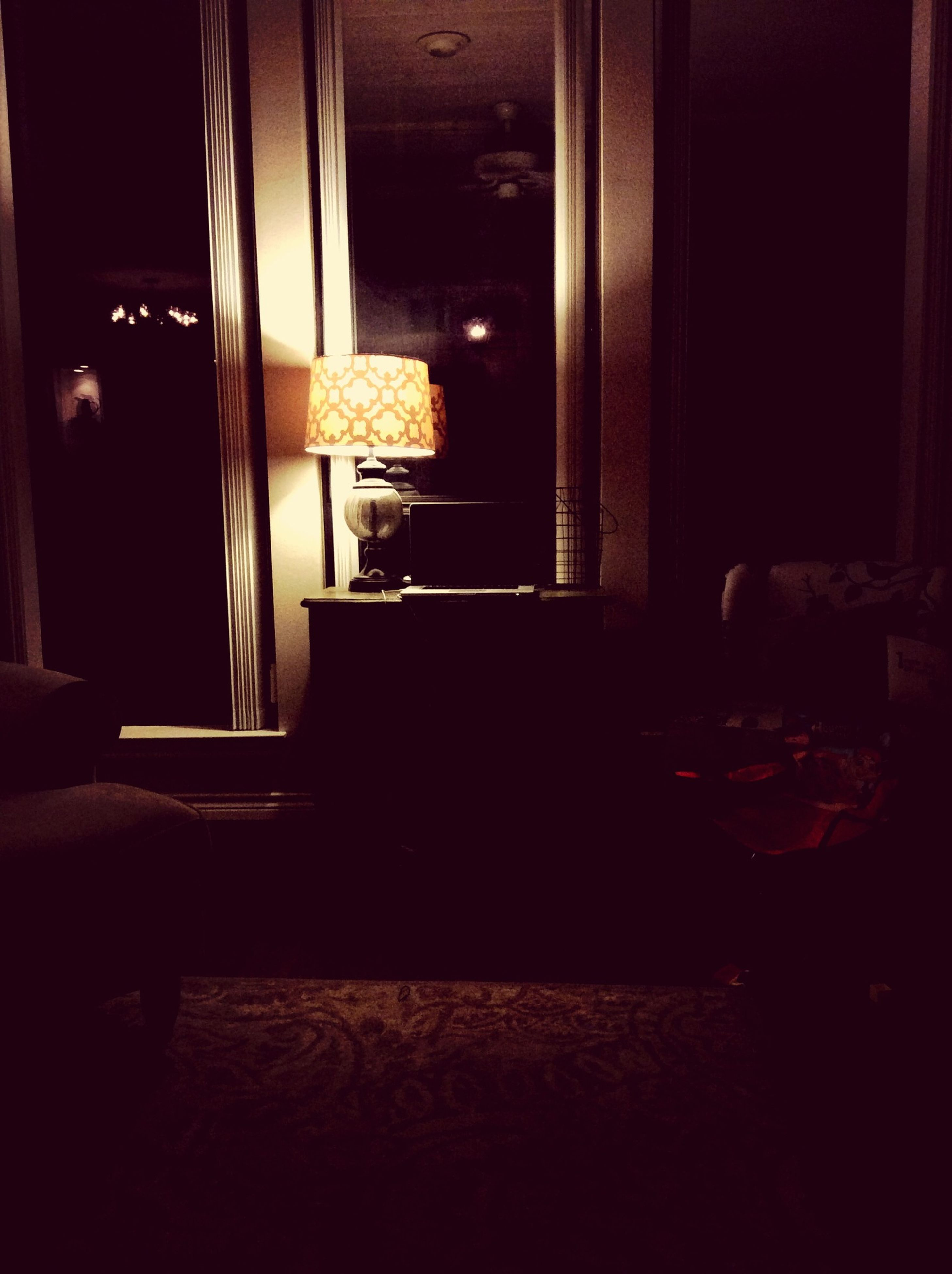 indoors, window, house, home interior, night, illuminated, dark, built structure, architecture, table, door, glass - material, room, no people, darkroom, wood - material, building exterior, chair, domestic room, transparent