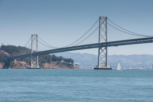 San Francisco Bay Bridge Blue Bridge Bridge - Man Made Structure Built Structure Connection Day Engineering Nature No People Outdoors River San Francisco San Francisco Bay San Francisco Bay Bridge Sky Travel Destinations Water