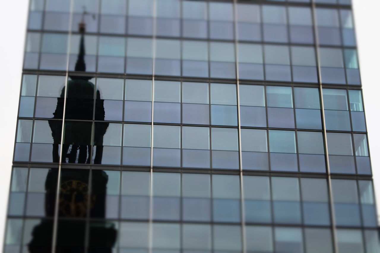 window, low angle view, outdoors, building exterior, day, window washer, cleaning, sky, architecture, occupation, no people, close-up