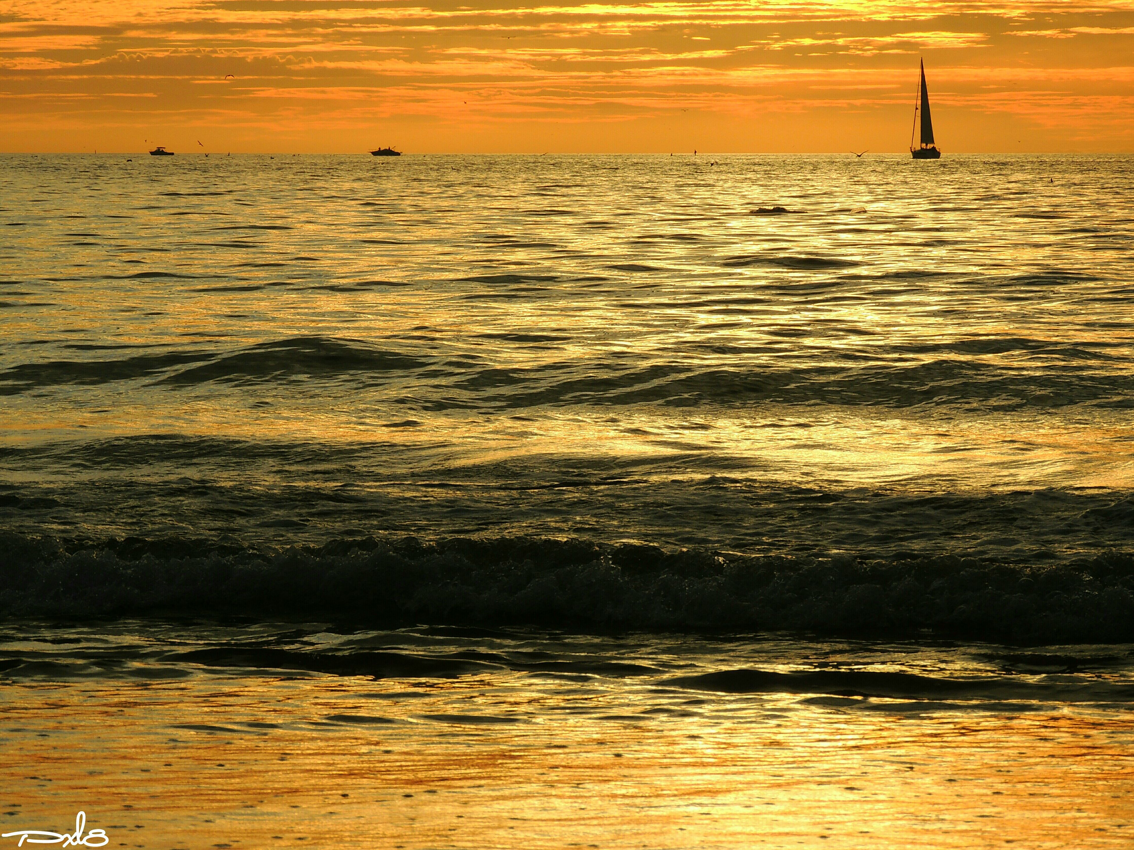sunset, sea, water, horizon over water, scenics, orange color, tranquil scene, beauty in nature, tranquility, waterfront, sky, idyllic, nature, silhouette, rippled, sun, seascape, beach, reflection, wave