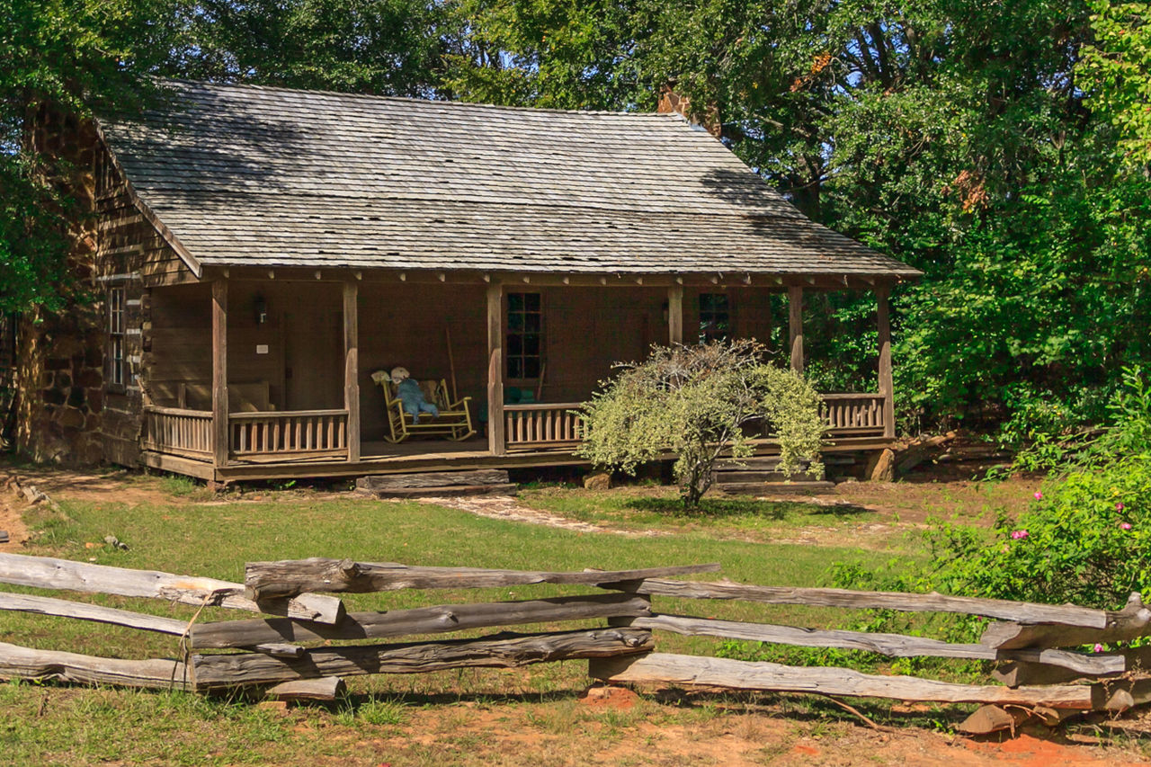 Built Structure Day Deterioration Empty Grass Green Color Green Shrub In Front Of Ca Growth Log Cabin Log Cabin Exter Nature No People Old Outdoors Plant Run-down Rural Scene Tranquility Tree Wood - Material Wood Art Wooden Wooden Railing Home Is Where The Art Is