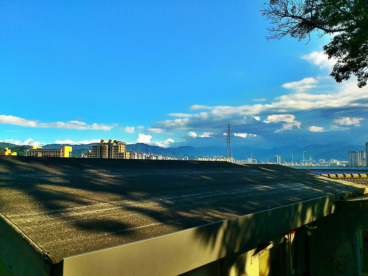 sky, architecture, built structure, outdoors, no people, day, water, building exterior, cloud - sky, blue, nature, sunlight, travel destinations, cityscape, sea, city, scenics, beauty in nature, tree