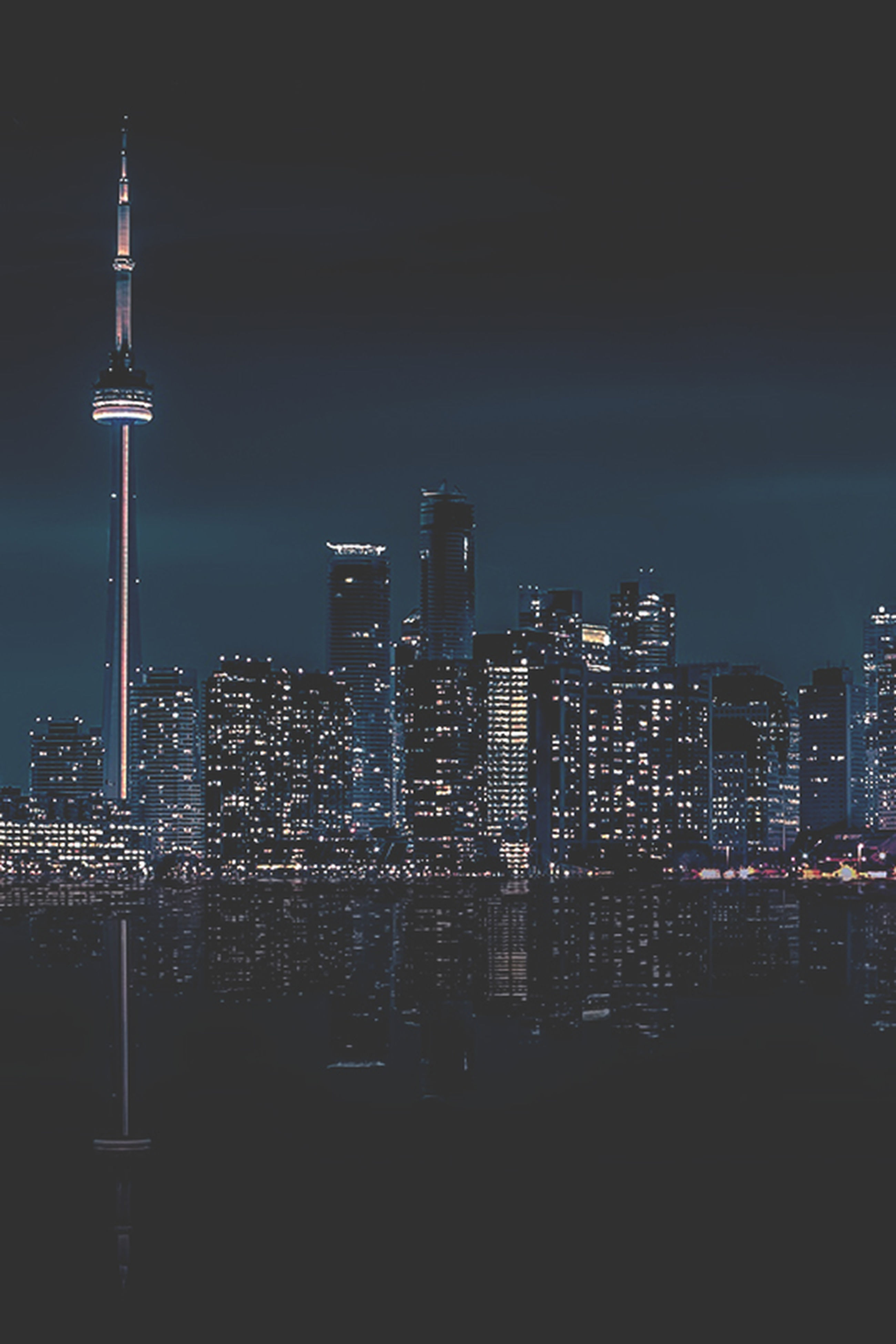 illuminated, architecture, building exterior, night, built structure, city, tower, skyscraper, tall - high, modern, cityscape, capital cities, communications tower, sky, office building, lighting equipment, travel destinations, famous place, spire, international landmark