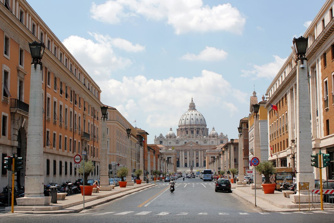 The Vatican basilica as seen from the via della concilliazione Architecture Building Exterior Built Structure Car Catholic City Cloud - Sky Day Dome Historical Building Italy Land Vehicle Outdoors Real People Road Rome Italy Sky Spirituality Transportation Travel Destinations Vatican Basilica Vatican City Via Della Concilliazione