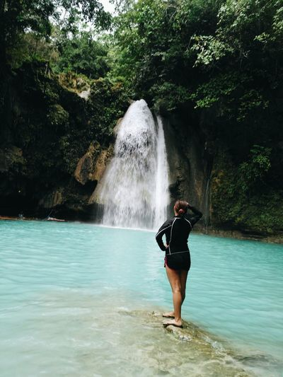 Chasing Waterfalls Waterfalls In Philippines Waterfalls And Calming Views  KawasanFalls Itsmorefuninthephilippines Nature Refreshment Lifestyles Waterfall Leisure Activity Adventure Beauty In Nature Outdoors Vacations One Woman Only Water Full Length One Person