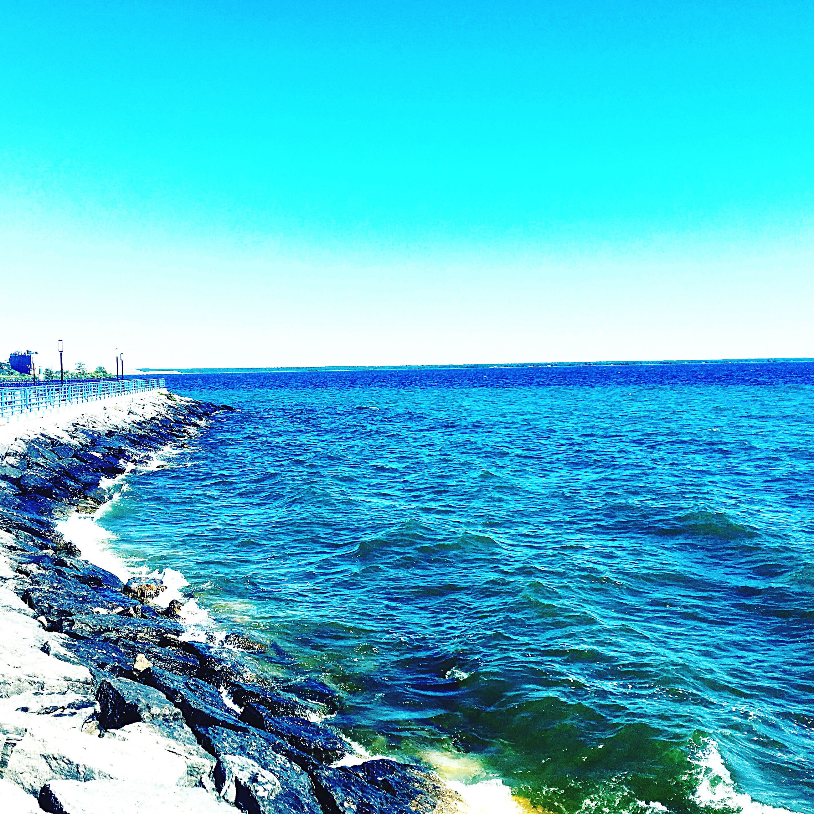 blue, clear sky, copy space, sea, scenics, horizon over water, water, tranquil scene, beauty in nature, tranquility, rippled, nature, seascape, day, outdoors, turquoise colored, majestic, no people, non-urban scene, waterfront, remote, coastline
