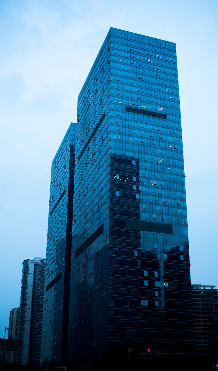 architecture, building exterior, skyscraper, built structure, low angle view, modern, sky, outdoors, day, city, no people, blue, tall