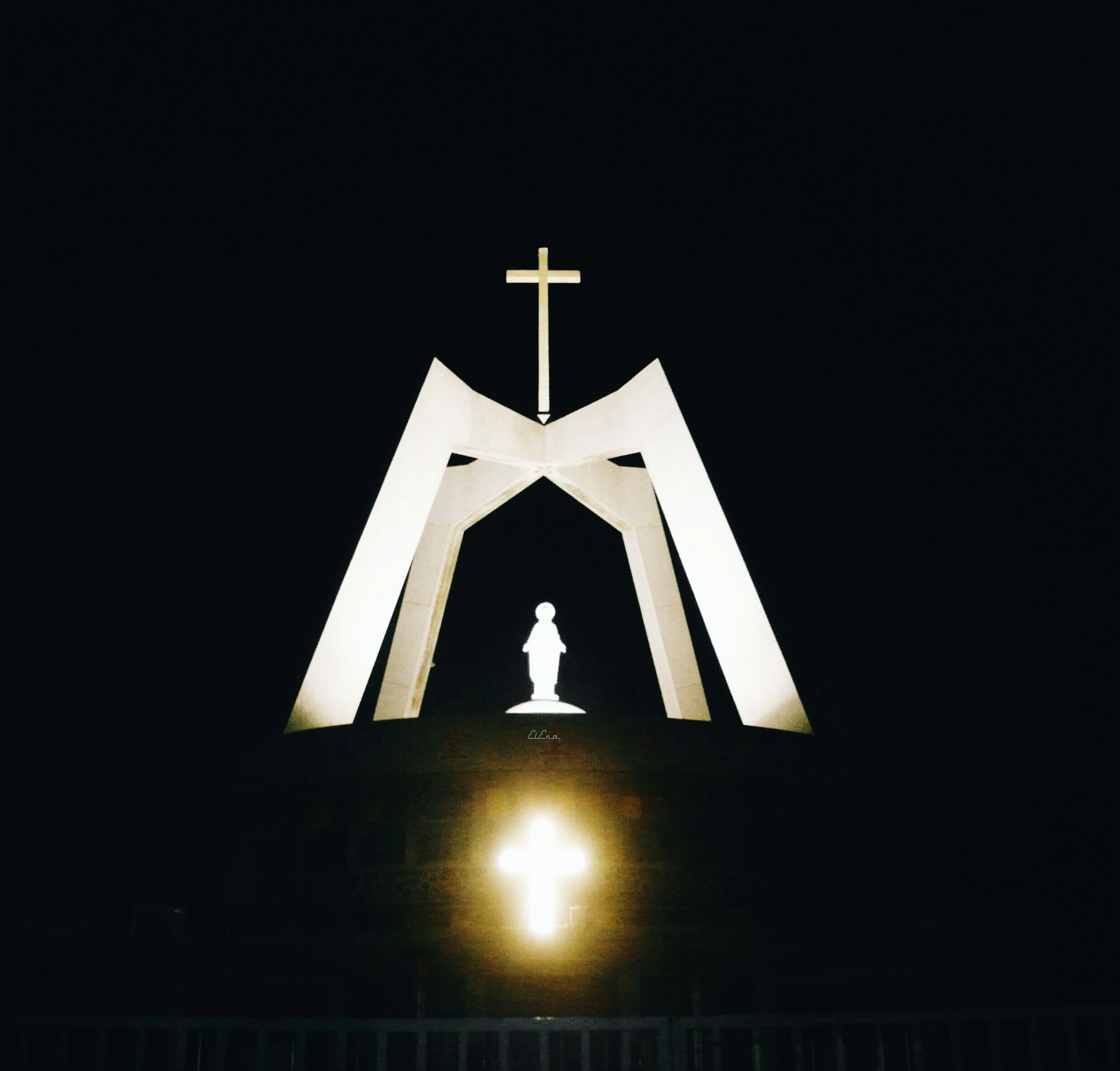 religion, spirituality, church, place of worship, low angle view, architecture, built structure, cross, building exterior, copy space, clear sky, night, high section, no people, dark, outdoors, human representation, illuminated