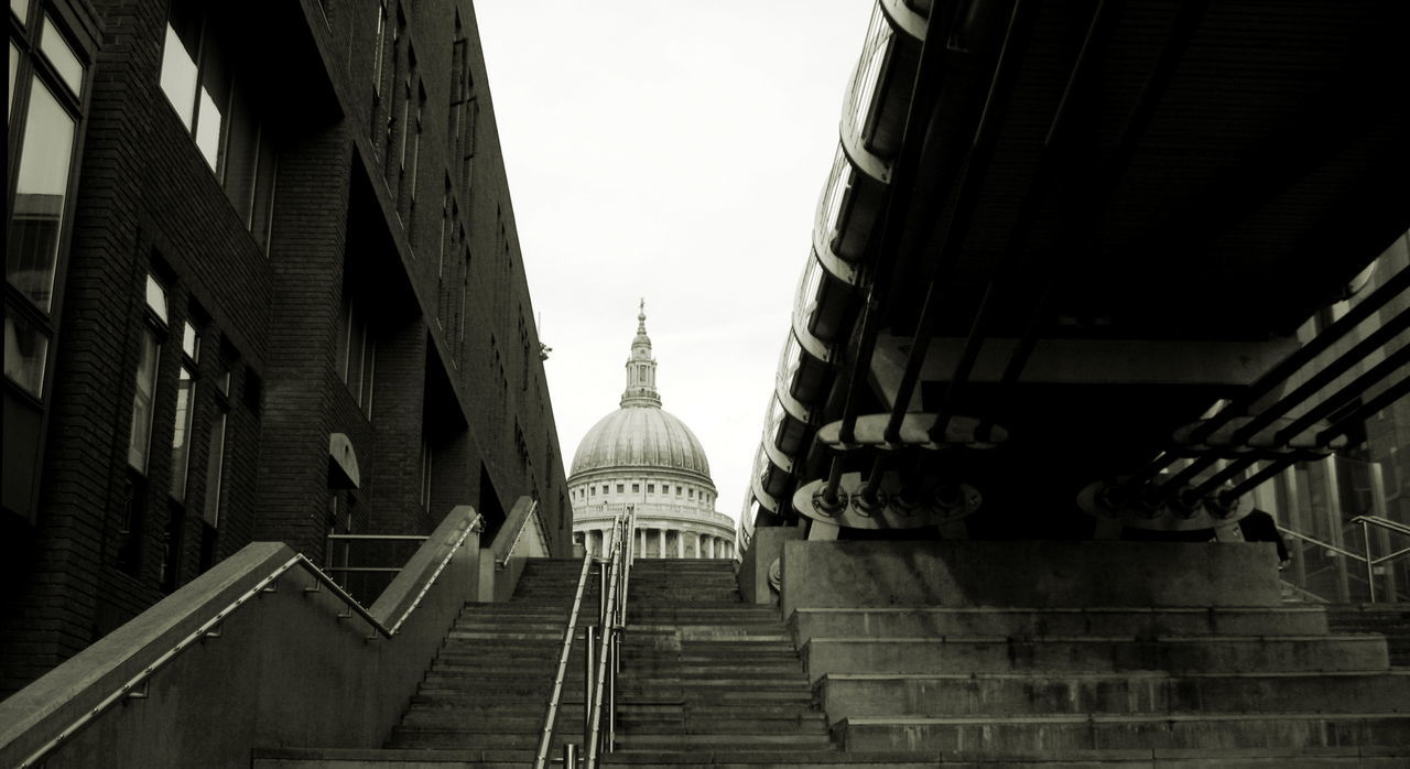 Under Millennium Bridge looking towards St Pauls Cathedral Architecture Bridge Bridge - Man Made Structure Bridges City City Life Civil Engineering Dome Embankment Engineering Grey Sky London Looking Up Millennium Bridge Mono Monochrome River Thames Bank Sights St Pauls St Pauls Cathedral Steps Tourism Tourist Under Underneath The Bridge