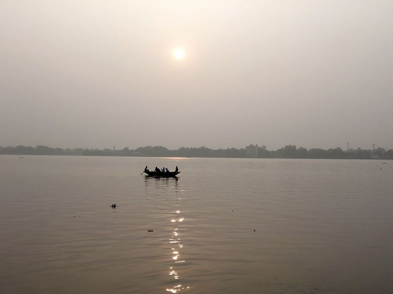 Taken this afternoon The Ganges River Ghats On The Ganges Fishermen on Boat Sun Reflection