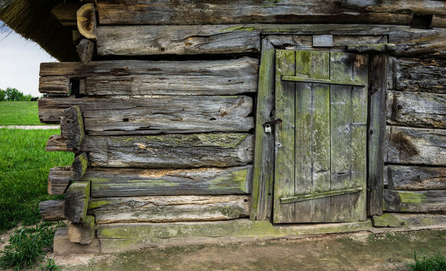 Detail of old wooden village house in Pirogovo museum, Kiev, Ukraine Architecture Bench Building Exterior Built Structure Cabin Closed Day Detail Details Door Door, Doors Green Color History House Houses No People Old Old Buildings Outdoors Rural Scene The Past Weathered Wood - Material Wooden