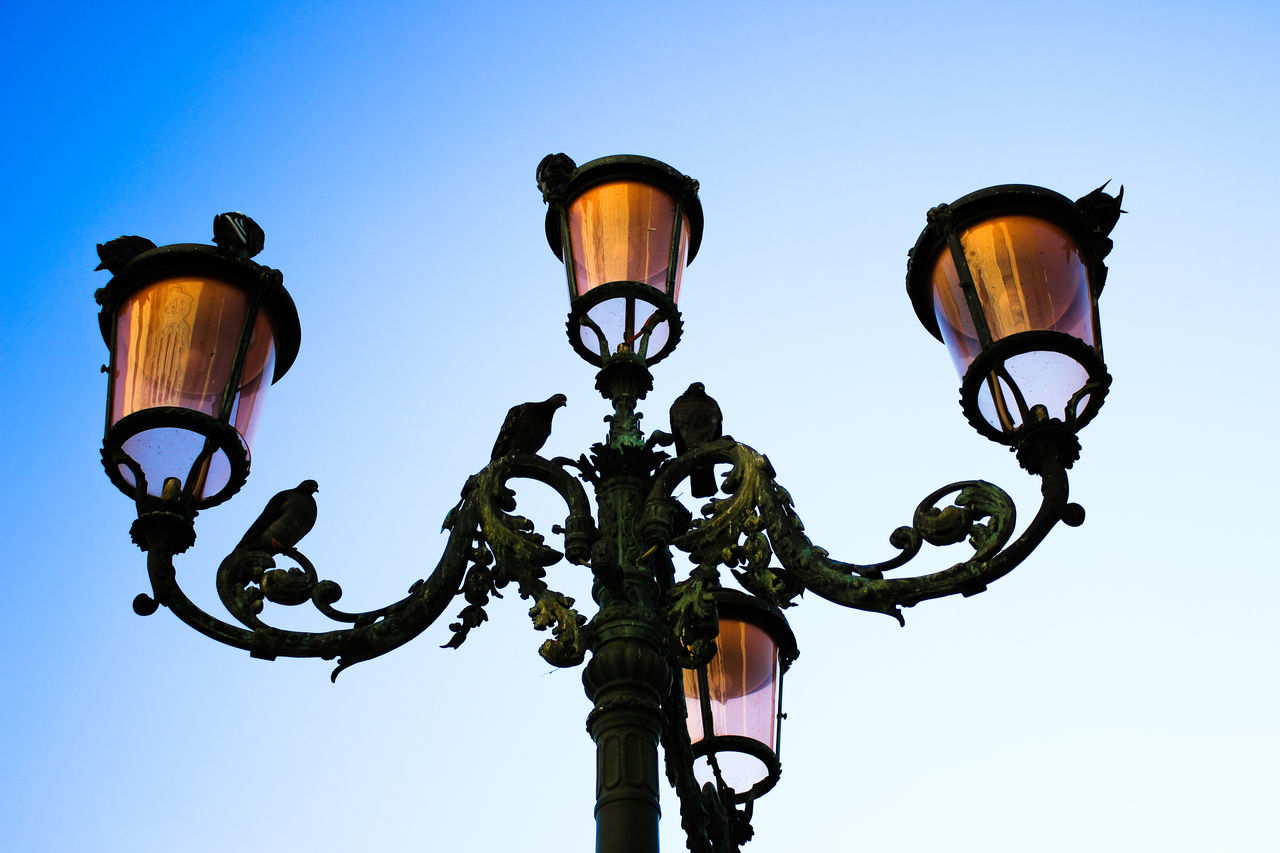 low angle view, lighting equipment, clear sky, street light, sky, outdoors, statue, no people, sculpture, gas light, day, architecture, nature, close-up
