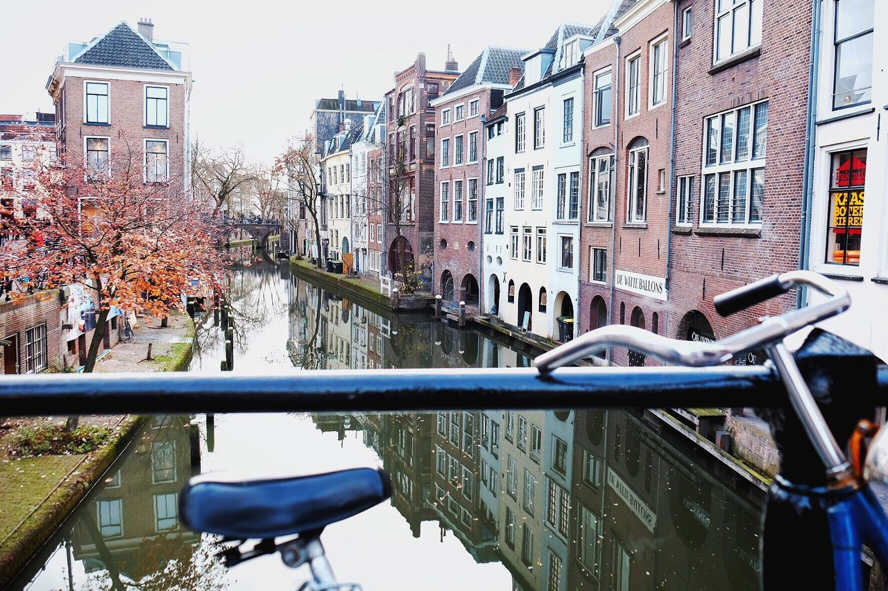 building exterior, architecture, built structure, water, canal, mode of transport, transportation, outdoors, day, reflection, waterfront, no people, nautical vessel, city, nature, tree