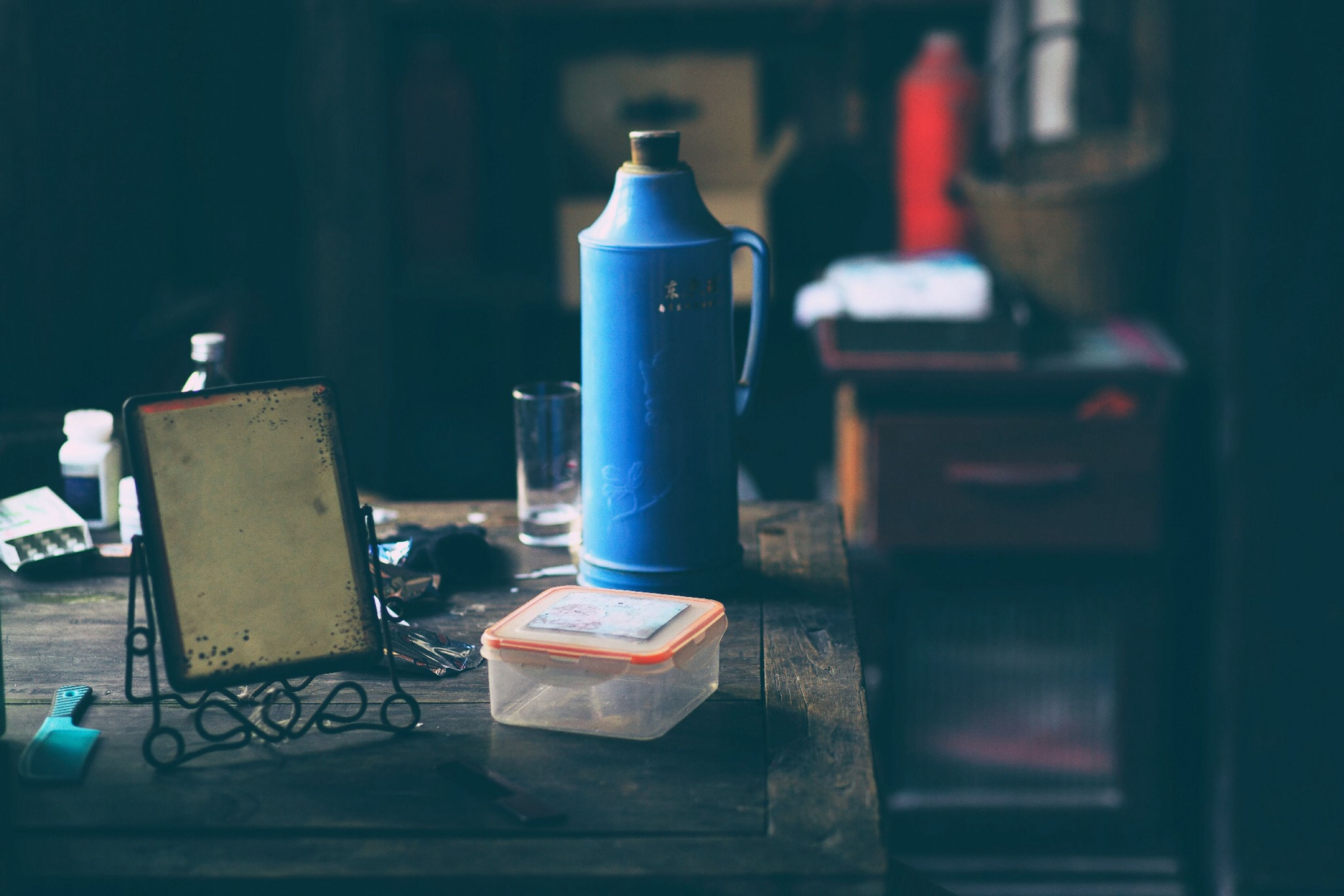 indoors, metal, still life, close-up, equipment, old, no people, old-fashioned, wall - building feature, focus on foreground, man made object, table, selective focus, metallic, wood - material, technology, bottle, machinery, blue, electricity