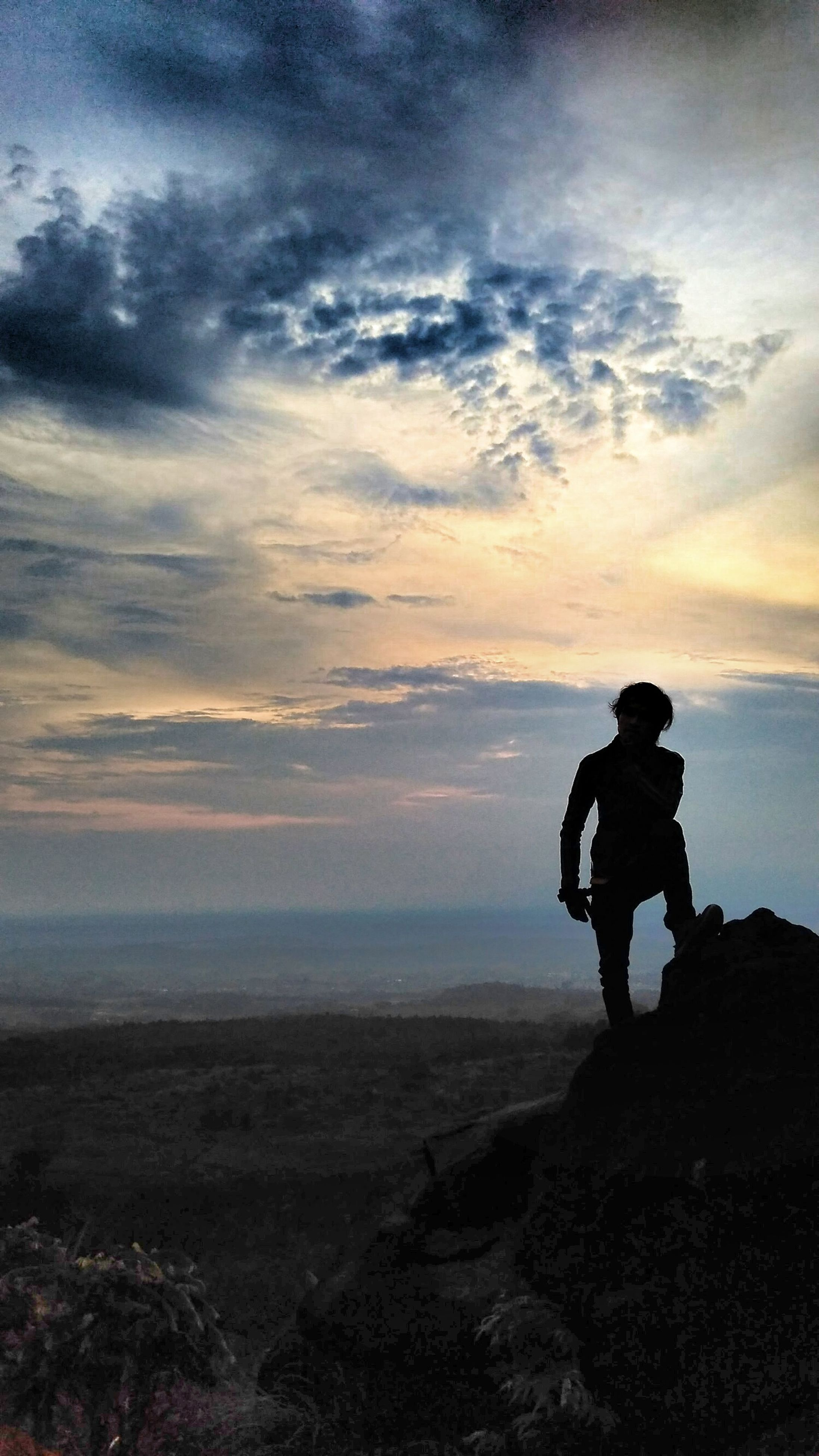 lifestyles, sky, leisure activity, full length, men, cloud - sky, scenics, beauty in nature, standing, tranquil scene, tranquility, rear view, landscape, nature, silhouette, getting away from it all, looking at view, rock - object